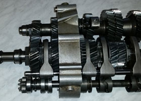 Helical sequential dog box gearbox transmission